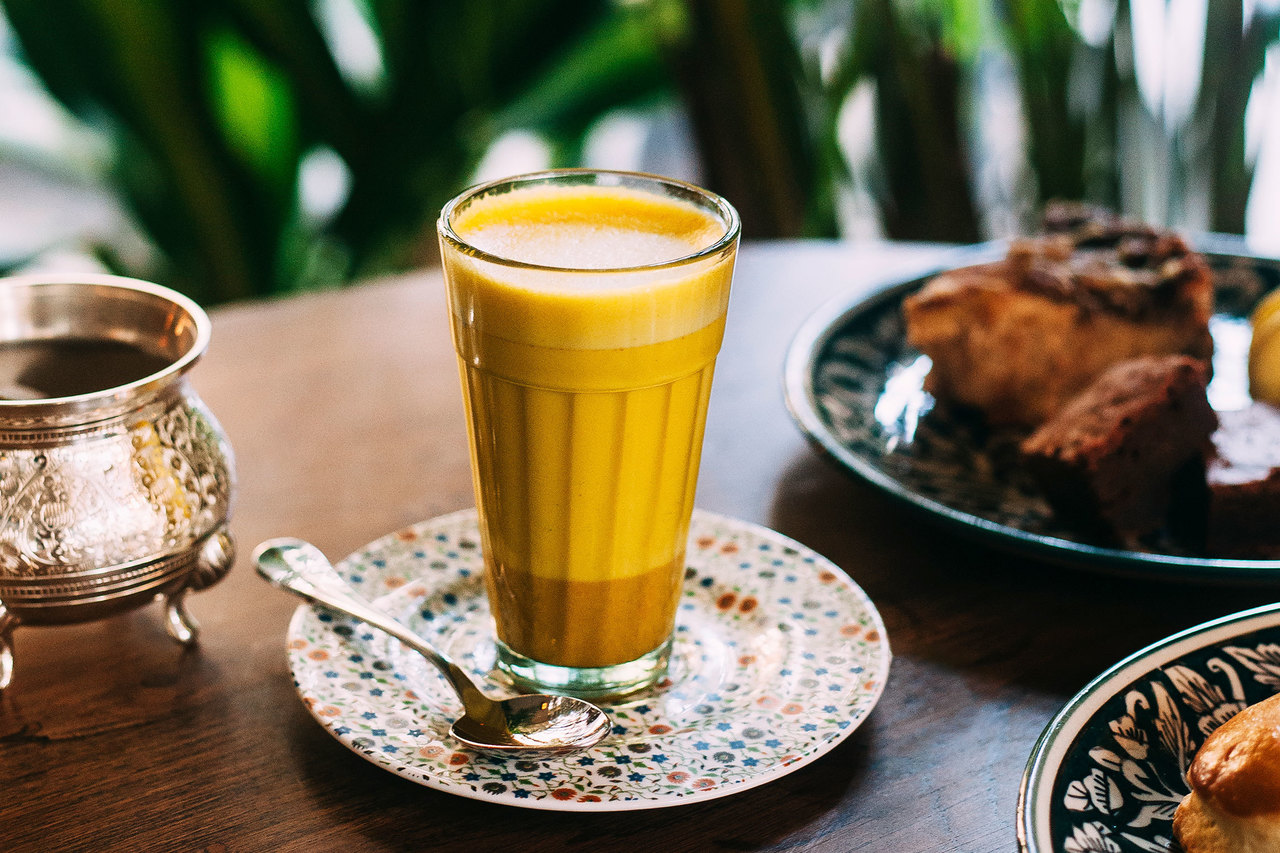 A juice and pastry from the breakfast menu